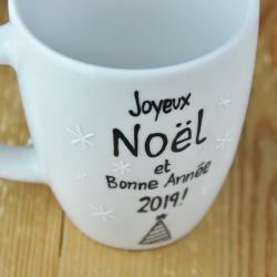 Kubek świąteczny. Z życzeniami w języku francuskim.